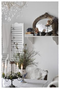 ~❤~ love how the dark mirror and other items break up the white.