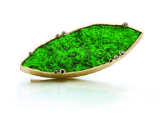 Brooch in 18k gold with marquise-shape green garnet and black diamonds by Barbara Heinrich