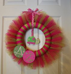 Tulle Wreath! Wrap the pieces of tulle around one of those green foam craft wreaths and knot in the back.