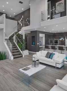 #homedesign #livingroomdecor #inspiration | Inspiration for a contemporary open concept living room in Edmonton with gray walls. — Houzz