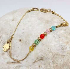 Handmade Colorful gold filled bracelet, Swarovski crystals, gold beads and Hamsa  charm. by MaYaJEWELRYDESIGN on Etsy https://www.etsy.com/listing/222233157/handmade-colorful-gold-filled-bracelet