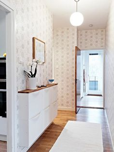 The wall-mounted Trones storage box can help in narrow entry ways especially if paired with hooks for coats and such.