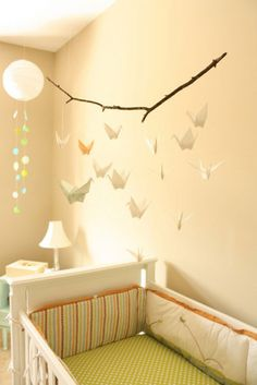 Add a whimsical touch to your nursery with a origami mobile. #mobile #nursery