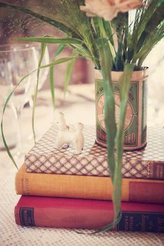 Vintage books would be cool for a centre piece along with vintage tins for the flowers