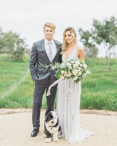 "How gorgeous does our bride look in the @truvellebridal ""Alexandra"" dress?! Especially standing next to her new hubby and adorable pup#realbride #bride #bridal #loveandlace #wedding #truvelle #romantic #family"