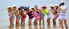 Tourists pose for photos on a beach in Bali. The island has bounced back and hosting the world's leaders for APEC shows the popular destinat. Malaysia Tourism, Malaysia Travel, Denpasar, Kuta, Bali, Malaysia Truly Asia, Tourism Industry, Poses For Photos, Facebook Photos