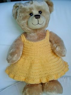 Lovely summer crochet dresses for 15 bears - great for build a bears. This is an easy crochet pattern using only double crochet and treble. Lovely summer crochet dresses for 15 Crochet Teddy, Crochet Bear, Cute Crochet, Crochet Toddler, Crochet Summer, Crochet Gifts, Crochet Animals, Crochet Doll Dress, Crochet Doll Clothes