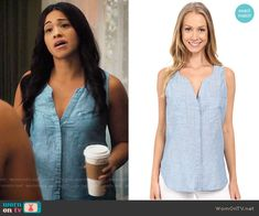 Jane's blue sleeveless split-neck top on Jane the Virgin. Outfit Details: https://wornontv.net/64737/ #JanetheVirgin