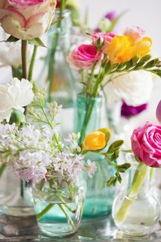 Break up a bouquet of colorful spring flowers to place all around the house.