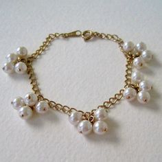 Vintage 1986 Traditional Cottage Chic Signed Avon Pearlessence Cluster Goldtone Faux Pearl Bracelet by ThePaisleyUnicorn, $8.00