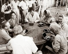Anticipating trouble on the Night of the Iguana set, John Huston tries to lighten the mood by giving Producer Ray Stark, Ava Gardner, Dick, Liz, Deborah Kerr and Sue Lyon gold plated derringers, each with 5 bullets engraved with the others names! On location in Puerto Vallarta, MX - 1964.