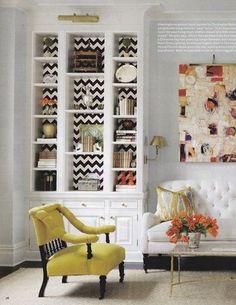 Bookshelves with unexpected peek of wallpaper