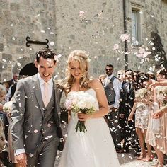Another gorgeous confetti shot outside @chateaudelisse chapel of Laura and John by the very talented @dareksmietanaphotography  Laura's rose and peony bouquet suited her dress perfectly #southwestfrance #ceremony #confetti #frenchwedding #bridalbouquet #france #ido #bridetobe #weddingvenue #destinationwedding #weddingphotographerfrance #floristinfrance #florist #weddingflowers