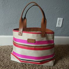 Kate Spade - Oak Island stripe magazine tote bag Kate Spade Oak Island tote. Cloth with genuine leather straps. Beautiful bag, extra roomy. Inside is in excellent condition, cloth on the outside is perfect except for the corners on the bottom. Worst corner shown in the 4th picture. Thanks for looking! kate spade Bags Totes