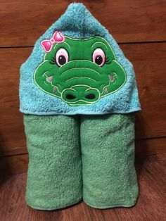 A personal favorite from my Etsy shop https://www.etsy.com/listing/492579236/girl-aligator-hooded-towel