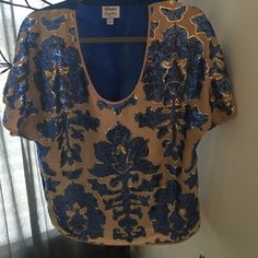 Neiman Marcus Sequin Tunic Shirt OK. LOOK AT IT...NEED I SAY MORE??!!!!this shirt is I can't even explain how gorgeous it is. They truly took their time making this shirt. Size L. Fits sort of loose but has a nice snatch to it at the waist loose on the arms...cute with maybe some ripped short shorts and simple flip flops it makes a statement by itself. Worn just once Neiman Marcus Tops Tunics