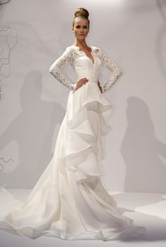 Great Dennis Basso Elena organza and lace A line wedding dress with lace long sleeves and a flowing peplum skirt Dennis Basso See more Dennis Basso wedding
