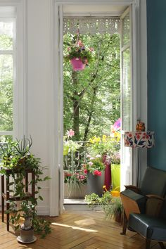 Balcons et terrasses fleuris - botanic® > View through a window #windows #balcony .