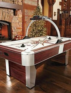 A handsome upgrade to a game room favorite, the Air Powered Hockey Table is the perfect gift for the game-lover in your life.
