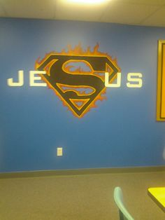 Painted super hero themed sunday school classroom wall