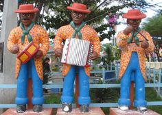 Representation of traditional Brazilian forro trio, with drum, button accordion and triangle. Forro stars today all seem to play piano accordions.