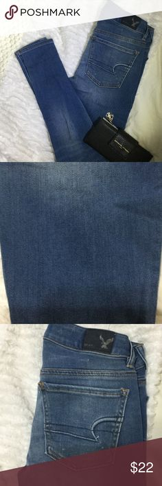 Chic Skinny Jeans In good condition, these pants feature light distressing on both knees and light polka dots. Medium wash with fading. American Eagle Outfitters Jeans Skinny