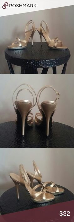 BCBG Paris yellow gold heels size 6 BCBG Paris yellow gold strappy heels with rhinestone decoration. Made in Brazil, leather upper. Wore one time to a wedding. :) BCBG Shoes Heels