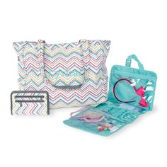 She's the one who can find what moves you, and our solution set will keep her in motion even on the busiest days!     This set features the Retro Metro Tote in Party Punch, Timeless Wallet in Party Punch and Timeless Beauty Bag in Turquoise Cross Pop.