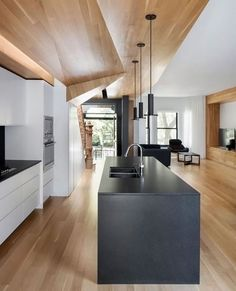 Same wood on floor and ceiling separating spaces without barriers. DARA