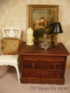 Carved wood dresser staged...