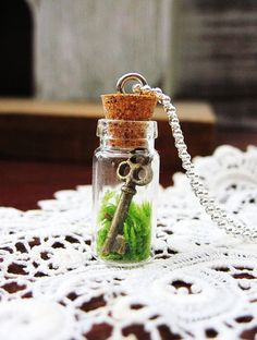 Please do not make me wear this. lol  (Living Terrarium Necklace The Key To My Heart by DoodleBirdie, $22.00)