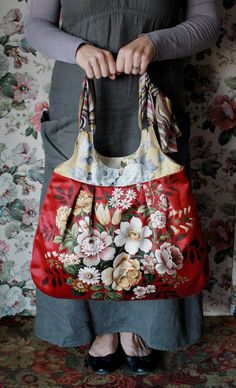 Meet Harriett...'she is is one of those girls who is beautiful inside and out' she is made from gorgeous vintage Sanderson floral sateen. She likes to be taken out for shopping and a spot of lunch and she likes to think she is not only a bag but a rather pretty accessory to your daily wear. When not in use she likes to be hung on a wall so all can share in her beauty.