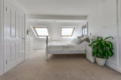 Hip to Gable master bedroom Isleworth Hip to Gable with a rear dormer master suite