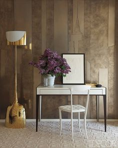 A Mod, Mod World - The wall panels in the master bedroom's sitting area evoke the New York City skyline; a desk by Nicolas Aubagnac holds a Tamara de Lempicka drawing, the chair is by Archirivolto, and the floor lamp is by Philippe Hiquily.