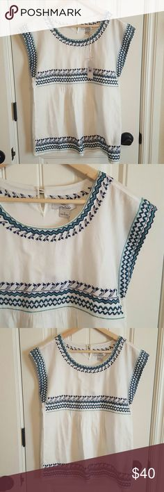 NWT Crossstitch Babydoll Top White with blue and green cross stitch pattern. Cap sleeve, loose and flowy. New with tags. Purchased on vacation, never worn. Beautiful for Spring, great with jeans! Tops Blouses