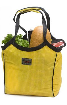 The Shop Bag by Bihn can fit: 1 large head of lettuce, 2 medium apples, 2 canned goods, bag of pasta, small soup box, 12 ounce coffee bag, large loaf of bread, Toblerone candybar, 25 fl oz mineral water, 24 fl oz beer, pint of ice cream inside of Stuff Sack >> Would love to put this to the test, I love a sturdy shopping bag! Love the simple grid pattern too.