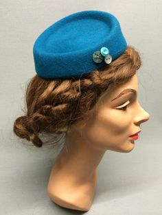The Dorothy is a versatile little fascinator with a serendipitous quality sure to enliven any gathering. Trimmed with a selection of fun vintage buttons which compliments the subtle felt colour. Colour: Teal #Fabhatrix #Edinburgh #Grassmarket #hat #felt #fascinator #occasion