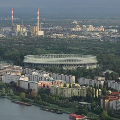 The view towards the Ernst Happel #Stadium the home of the #Austrian National #Football Team in #Leopoldstadt from Bar 58 on the 58th floor of the #Meliá #Hotel in the #DCTower #DonauCity #Vienna. Behind is #Kraftwerk #Simmering #PowerStation. #landscape #city #urban #sport #Austria #IgersVienna #IgersWien #IgersAustria #River #Danube #ErnstHappel #Stadion #travel #tourism #tourist #leisure #life #education