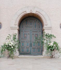 Simple floral frames the entry to Our Lady of Mount Carmel Church.  Built in 1856, it's one of my favorite churches in California. @josevilla @lauriearons #montecito