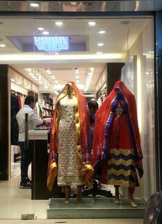 Cotton studio in rajouri has a vertical open window display.. with proper lighting on the mannequins.