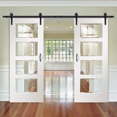 Thruslide Traditional Severo White 4L Sliding Double Door - Clear Bevelled Glass - Prefinished - Lifestyle Image. #slidingdoor #barndoors