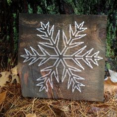 These snowflake string art pieces are hand strung on aged wood. We can do any custom order. Get in touch with us!