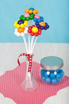 Make cute party centerpieces / flowers out of gum balls! Via Kara's Party Ideas KarasPartyIdeas.com