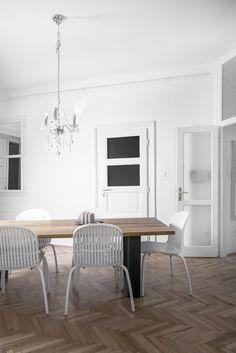 Dining room - chandelier - herringbone floor - whiteness designed by Andras V. Lestak, photography by David Kovacs