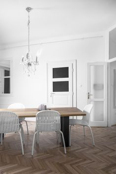 Dining room - chandelier - herringbone floor - whiteness designed by Andras V. Lestak, photography by David Kovacs