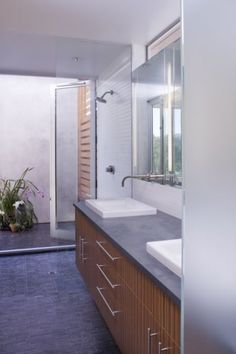 This shower falls on the indoor side of the dividing line; technically it's indoors, but with the doors open it's completely open to the patio on one side. This kind of setup gives a feeling of being open to the elements with a bit more privacy.