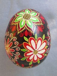 This traditional Pysanka has a colorful design. It was made with the traditional Ukrainian wax and dye technique. This Easter egg was made by real masters of this craft. It was hand painted on real hen egg shell. Egg Designs, Flower Designs, Painted Rocks, Hand Painted, Paste, Hen Chicken, Ukrainian Easter Eggs, Egg Art, Egg Shells