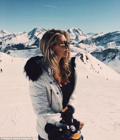 Natasha Oakley shows off shorter locks on holiday in the French Alps