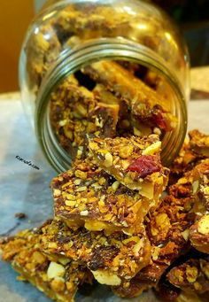 """Oat ChocoToffee klusters.Ok,these will have you in """"Hooked,""""in a New York minute.Handmade granola & toffee with dark chocolate mixed together to create Heaven on earth.These klusters will have you absolutely addicted."""