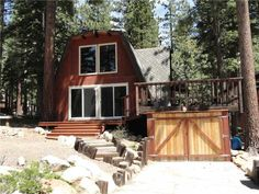SOLD! 955 Apollo - Price $559,000  Darling cabin with small lake views. Consider the possibilities! Great privacy with Nat'l Forest land across the street and to one side. One deep covered carport. Huge deck. 3 bedrooms, large loft and 2 full baths. Newer roof and recent refurbished interior. Front yard has drip irrigation system. BMP's complete, waiting for TRPA certificate.